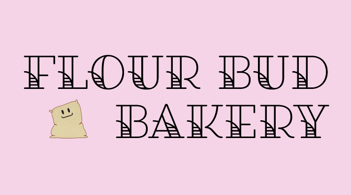 A light pink background with a flour sack tilted to the side with a smiling face on it next to the words Flour Bud Bakery.